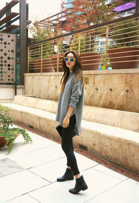 jeans negros ajustados con sweater largos