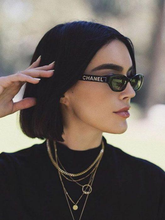 lentes de sol ovalados negros