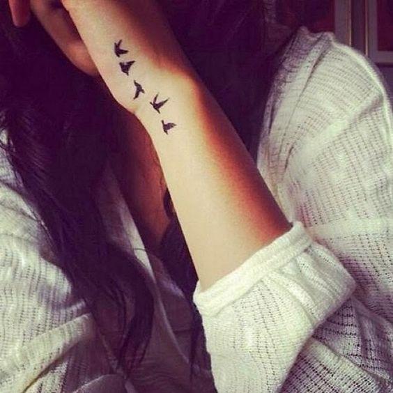 tatuaje silueta de aves