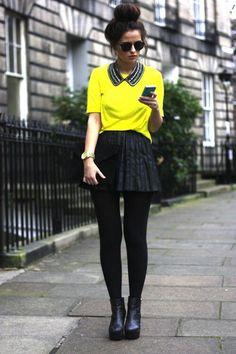 blusa amarilla con falda negra