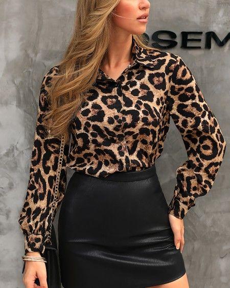 blusa animal print con minifalda engomada