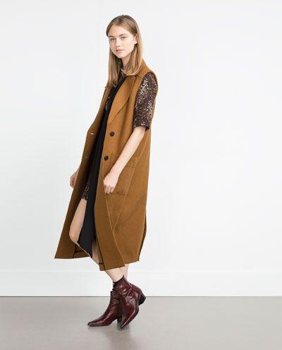 chaleco largo y vestido animal print