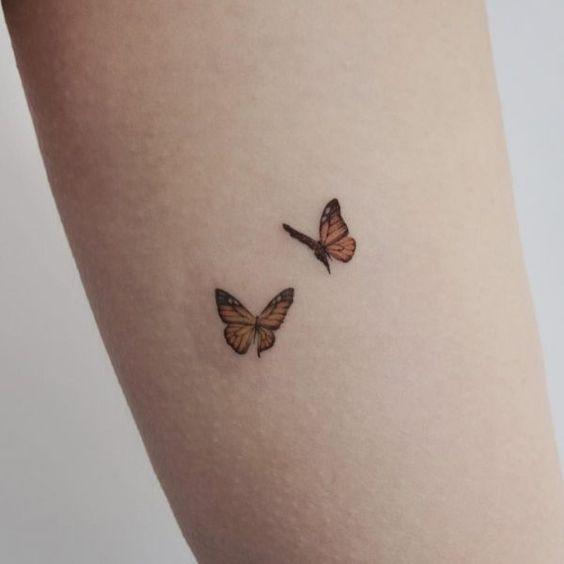 tatuaje de grupo de mariposas monarcas
