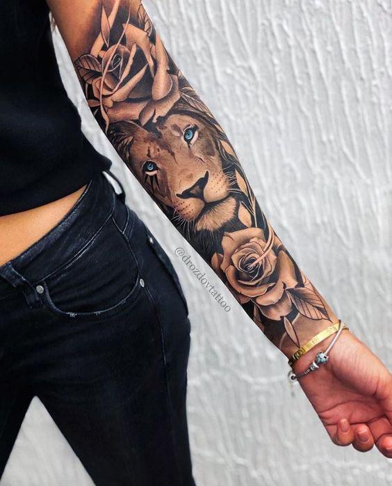 Tatuaje en parte interior antebrazo leon