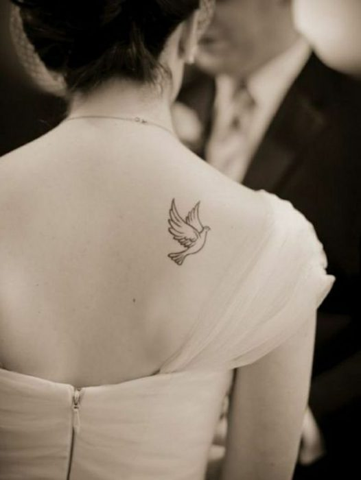 tatuaje chico de paloma