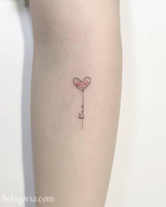 tatuaje corazon con nombres